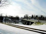 West Carthage, NY - Winter scene looking across the Black River toward West Carthage